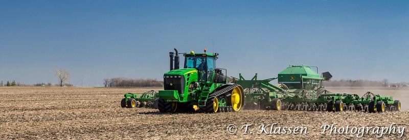 Siemens farm John Deere grain seeding equipment on the field near Plum Coulee, Manitoba, Canada.