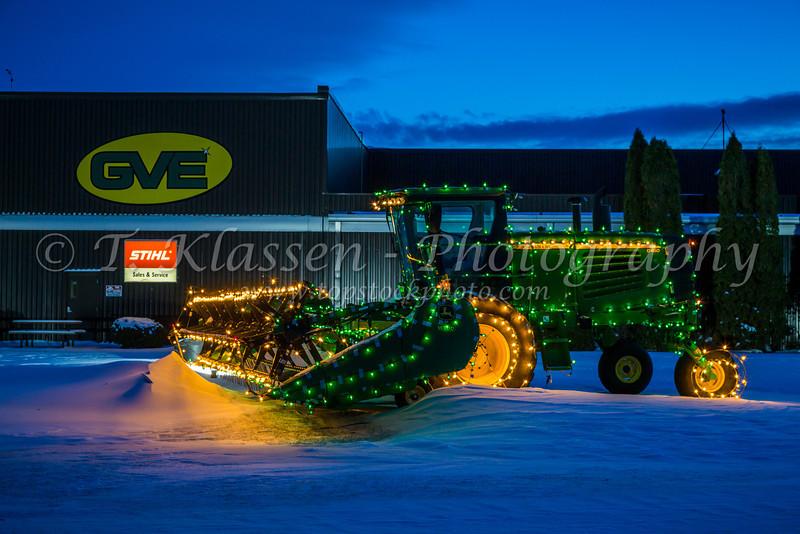 John Deere grain swather illuminated for Christmas near Winkler, Manitoba, Canada.
