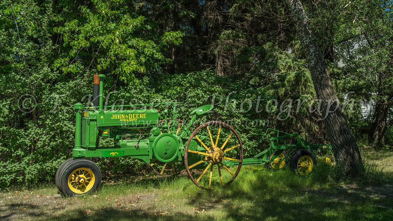 A vintage John Deere tractor and plow near Osterwick, Manitoba, Canada.