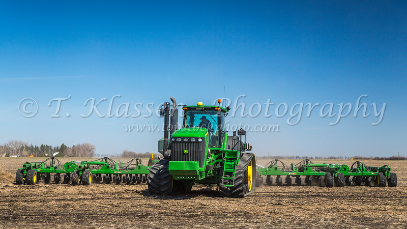 Siemens farm John Deere grain seeding equipment on the field near Plum Coulee, Manitoba, Canada.