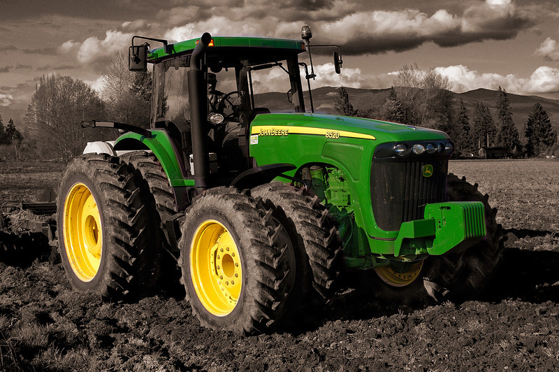 John Deere 4WD tractor with BW background