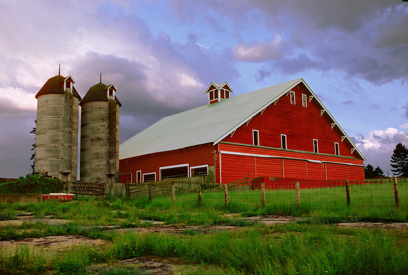 Century old red barn in unsettled weather