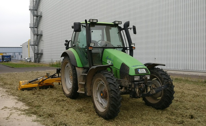 Deutz-Fahr Agroton 106 with grass cutter.
