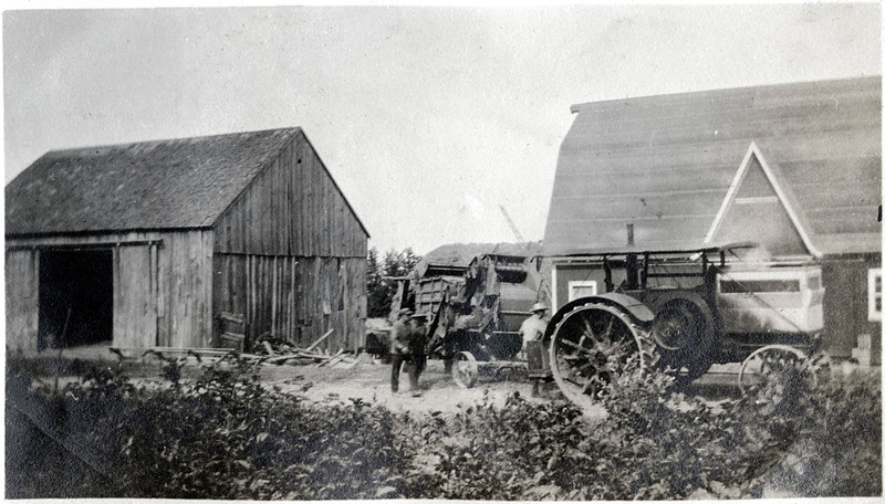 "Farm located on the corner of Bartnick and Route 90. The big barn was located about where the driveway to the Genoa offices are now. It was torn down in the late 1960's. The tractor pictured is an ""Avery tractor"" maybe an H model. (Photo ID: 37536)"