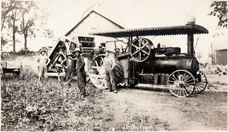 Bartnick family farm steam threshing. L-R Joe Mahaney, Herman, Uncle San Bartnick and Les Shaw. Herman is Han's step father. (Photo ID: 28129)