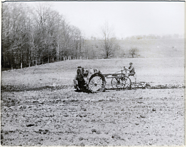 Doing field work with a Minneapolis Molene right after World War 1. John Baildon driving tractor.  (Photo ID: 28964)