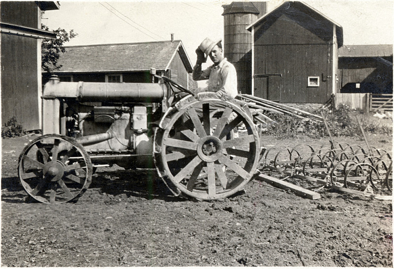 Sam Fessenden on a tractor at his farm in King Ferry, NY. (Photo ID: 29351)