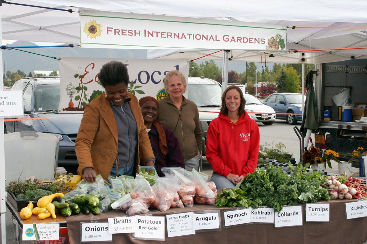 Fresh International Gardens farmers market table.