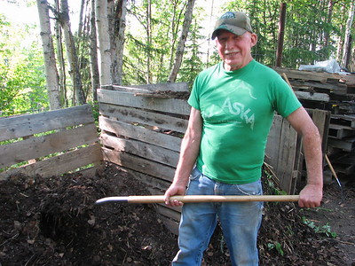 Man shoveling compost at Alaska Botanical Garden
