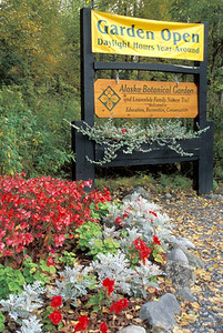 Alaska Botanical Garden sign with flowers