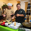 At the Summit reception at Mangaoali'i Government House, Chef Sam Choy engaged Governor Togiola in a cooking demonstration in the sitting room.