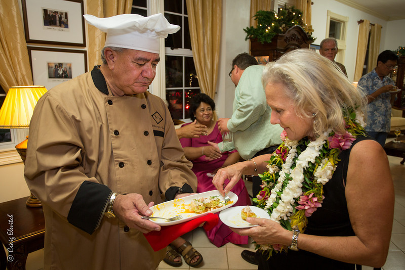 Governor Togiola serves the last of the ulu crab cakes to Dr. Diane Ragone.