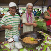 The mayor of Pago Pago demonstrates taufolo, a traditional dish with roasted ulu, sugar, and coconut cream.