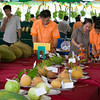 "Weighing fruit in the ""biggest fruit competition,"" which includes mangosteen, dragon fruit, santol, guava, papaya, durian, and jackfruit."