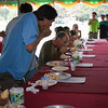 Craig Elevitch (center) competes in the durian eating contest (wins second place).