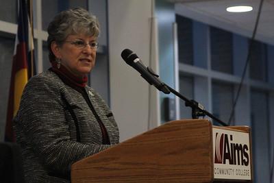 Board of trustee, Carol Ruckel speaks to the crowd.