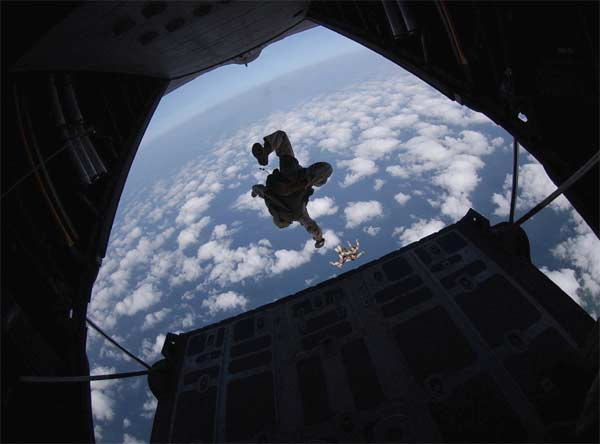 Airmen with the 304th Expeditionary Rescue Squadron jump out of an HC-130 Hercules operated by the 71st ERQS over the Gulf of Tadjoura, Djibouti, on Tuesday, March 28, 2006.