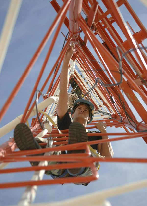 Senior Airman Robert Oehmke performs maintenance on an antenna tower Wednesday, March 29, 2006, at Davis-Monthan Air Force Base, Ariz.