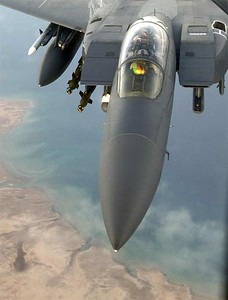 An F-15E Strike Eagle flies over a forward-deployed location in Southwest Asia. Aircraft like this are capable of monitoring battlespace with their targeting pods.