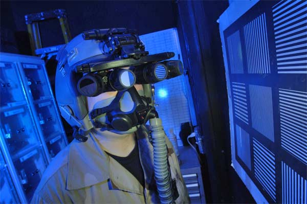 Tech. Sgt. Matthew Freeman does an operational check of panoramic night vision goggles Monday, March 6, 2006, at a deployed location.