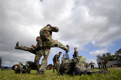 Tactical air controllers from the 25th Air Support Operation Squadron practice close-combat skills training Thursday, April 13, 2006, at Wheeler Army Air Field, Hawaii.