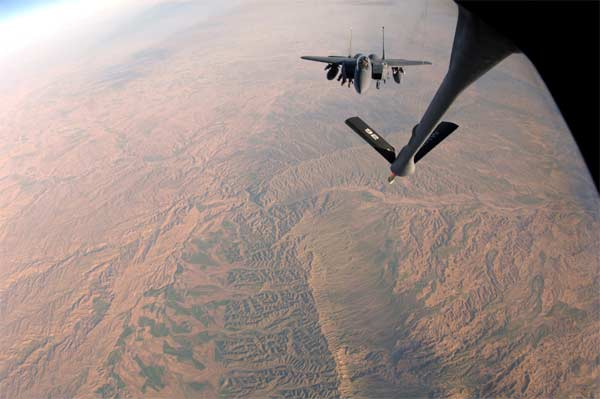 An F-15E Strike Eagle from the 336th Expeditionary Fighter Squadron is refueled over Southwest Asia by a KC-135 Stratotanker from the 340th Expeditionary Air Refueling Squadron on Tuesday, April 11, 2006.