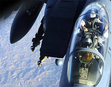 An F-15E Strike Eagle is refueled by a KC-135 Stratotanker over Southwest Asia on Tuesday, April 11, 2006.