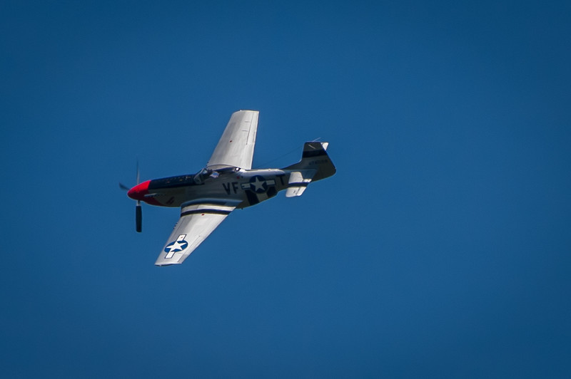 The sound of a P-51 Mustang is like the sound of a rattlesnake. Once heard, you'll always remember. I could hear him coming from a distance.<br /> Slick, Swift and very very Cool.