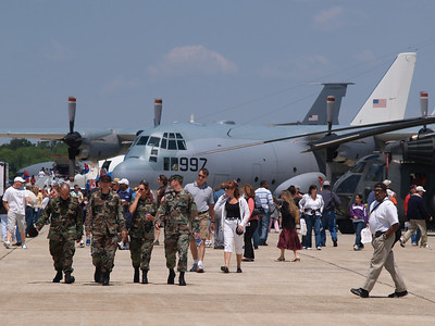 Visitors stroll through the Andrews AFB Joint Services Open House, May 19, 2007. C5A Hercules cargo plane is in background.