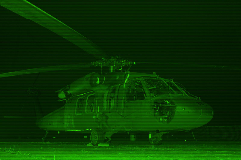 A Blackhawk rests at night. Photo was modified for nightscope effect.