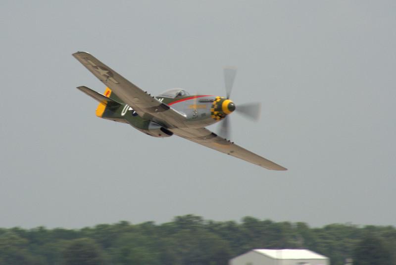 """A P-51 Mustang (""""<i>Gunslinger</i>"""") makes a high-speed pass."""