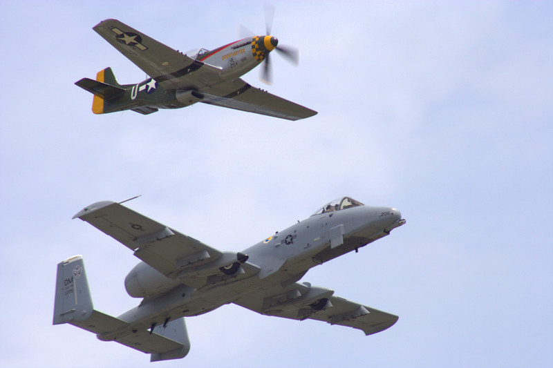 "Another view of a Heritage Flight: a P51 Mustang (the ""<i>Gunslinger</i>"") and an A-10 Thunderbolt."