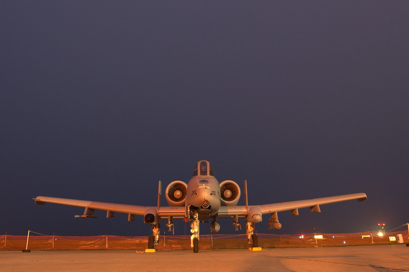 An A-10 rests at dusk.