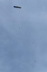 Three parachutist dropping from the Goodyear blimp