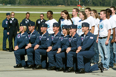 The 2007 Thunderbirds kneel and pose for pictures with a group of new Air Force Recruits who just took their oath of enlistment.