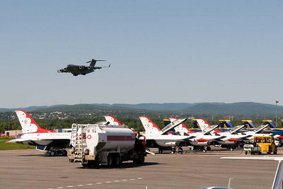 A Canadian CC-177, that will be on static display for the show, comes in for a landing on Thursday afternoon. In the foreground are the USAF Thunderbirds and USN Blue Angels planes parked next to each other.