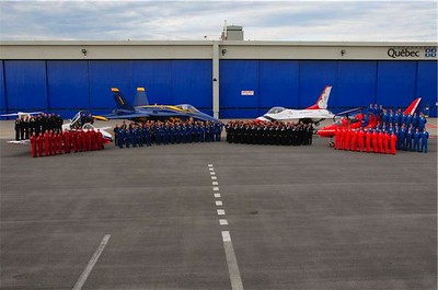 All four national jet teams pose for a photograph on Friday, June 13, 2008, prior to the start of the show. Included left to right are the Canadian Air Force Snowbirds, the U.S. Navy Blue Angels, U.S. Air Force Thunderbirds, and the British Royal Air Force Red Arrows.