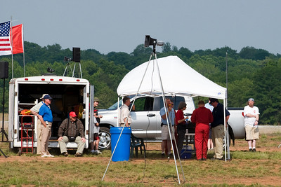 The announcer's tent for the show. The man in the all red jump suit is the Snowbird's announcer, who is getting ready to start the show.