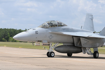 The first of two Navy F/A-18 Super Hornets arriving for static display during the Vidalia Onion Festival Air Show. The pilots are taking notice of me photographing their arrival.