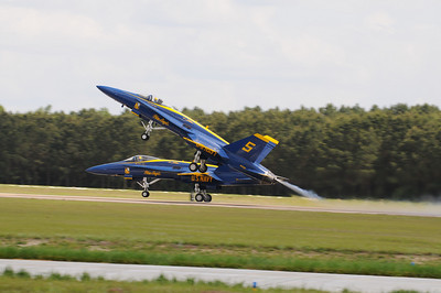 Blue Angels number 5 & 6 take off for the show. Number 5 does a steep angle take-off.