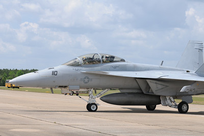 One of the pilots of this F/A-18 Super Hornet decides to wave for the camera as I am taking pictures of their arrival.
