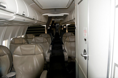 """The C-40C has all """"First Class"""" seating. This plane is configured to hold 40 passengers and up to 11 crew. The center section contains a conference room area."""