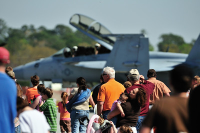 The crowd at the Columbus 'Thunder In The Valley' Air Show stands back as the F/A-18 Super Hornet taxis back to a static display position, after it completed a demo flight.