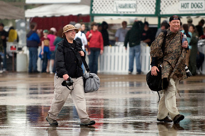 A couple of members of the Fencecheck Photopit, dodging the raindrops on Saturday.