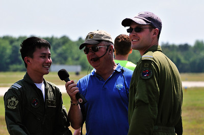Hugh Oldham interviews two pilots who came with a Canadian Dash 8 on static display. The pilot on the left is actually a member of the Singapore Air Force.