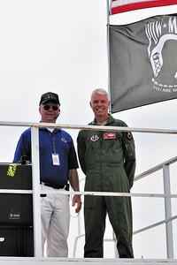 Hugh Oldham (air show narrator) and Eglin AFB Base Commander Major General CR Davis.
