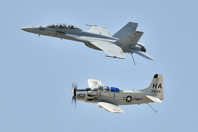 "The Navy ""Tailhook"" legacy flight with an AD-5 'Skyraider' and a F/A-18F Super Hornet."