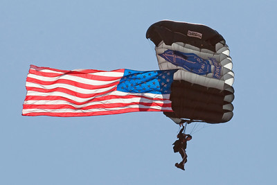 The U.S. Army Airborne Silver Wings parachute demonstration team opened the show with the American Flag jump.