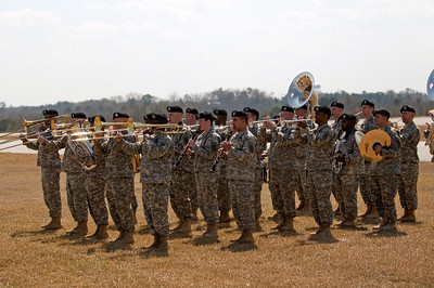 The Fort Benning Army Band plays the national anthem.