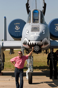 Richard Williams of the Vidalia Convention and Vistors Bureau stands by the A-10 Demo Team plane.